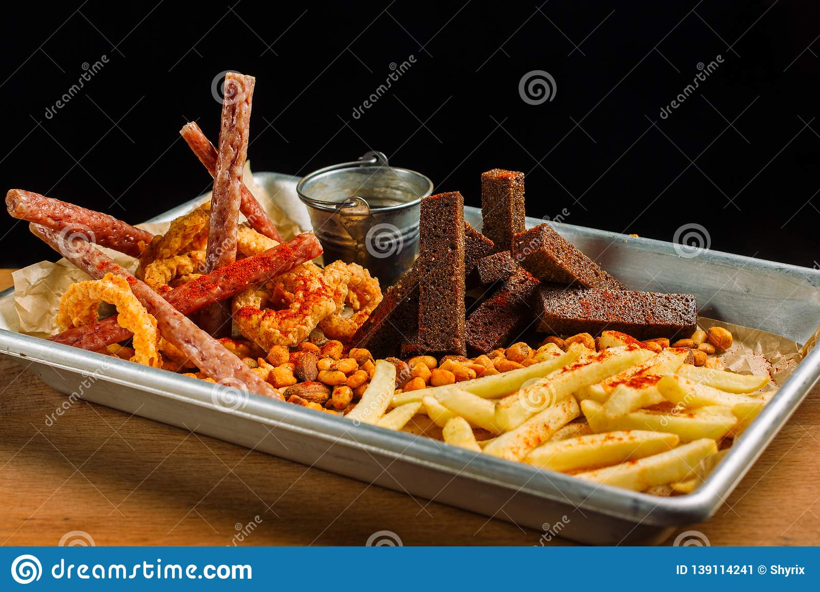 Snack to beer. Beer metal tray with a mountain of food.