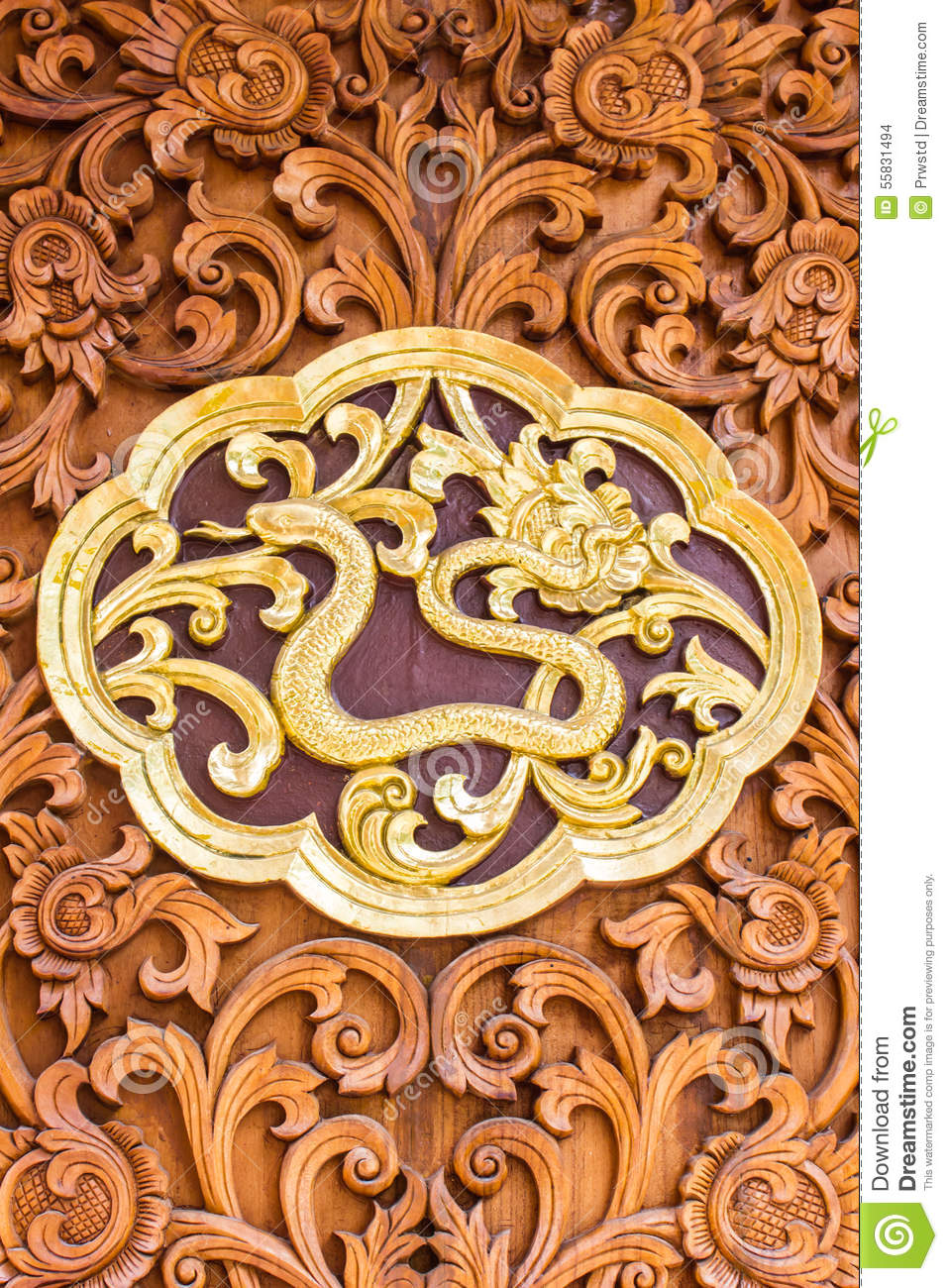 Golden sculptures on the wall in temple royalty free stock