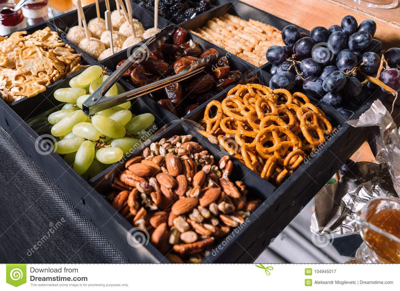 Snacks for beer-grapes, almonds, dates.