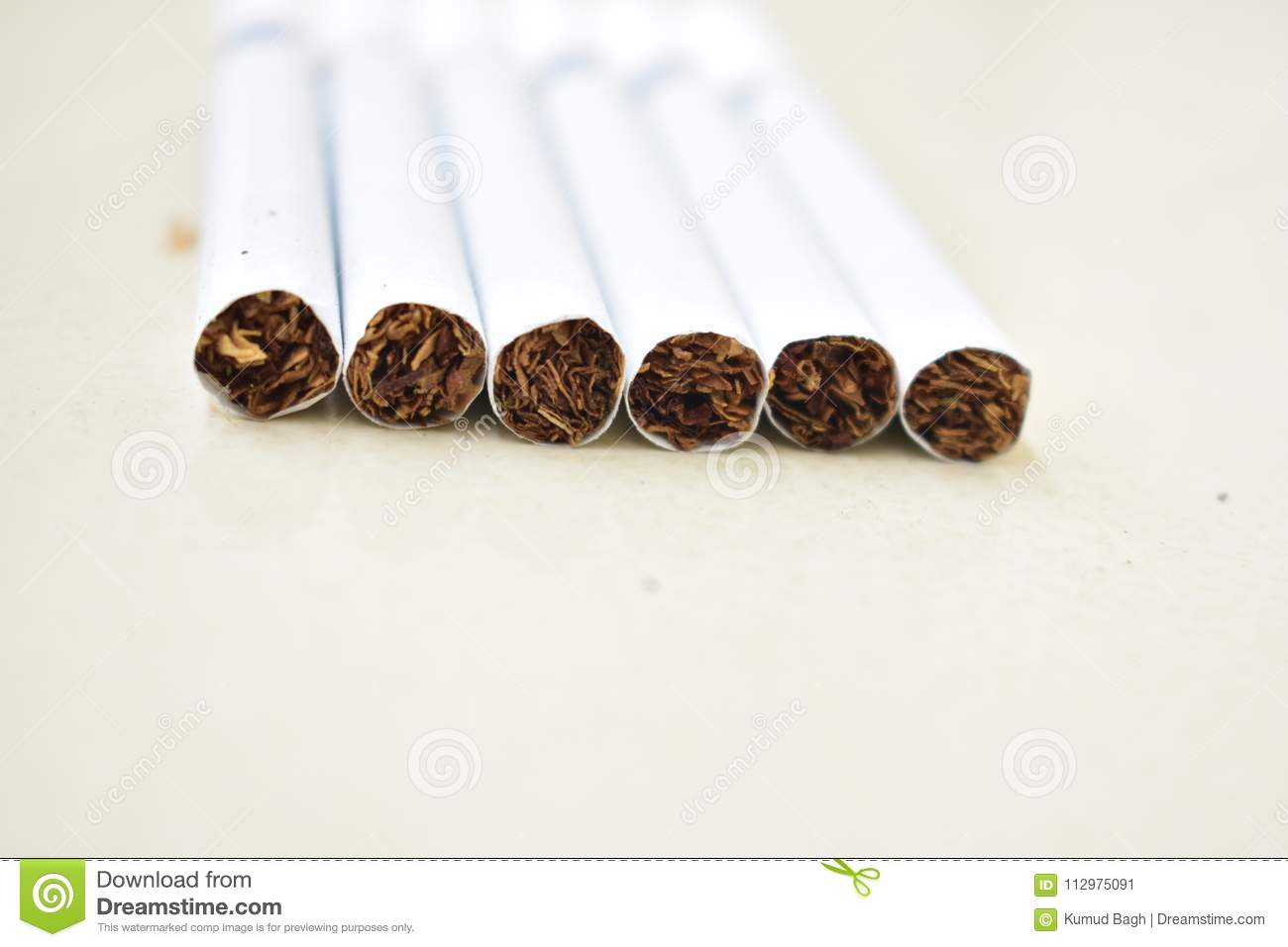 A close look bunch of cigarette at floor.