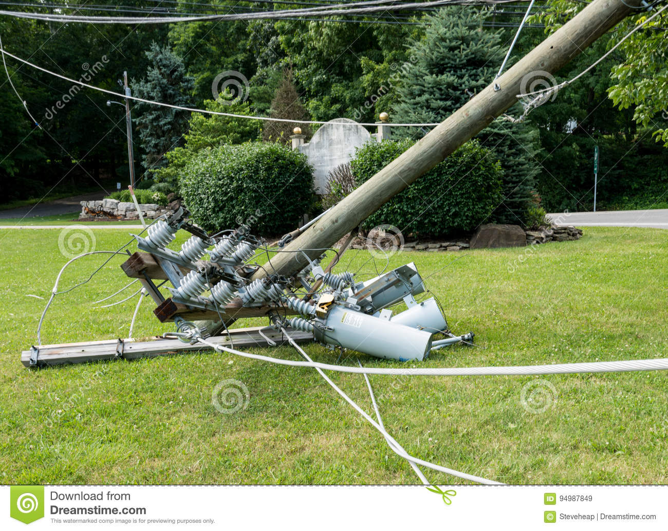 Snapped and downed power post and line after storm