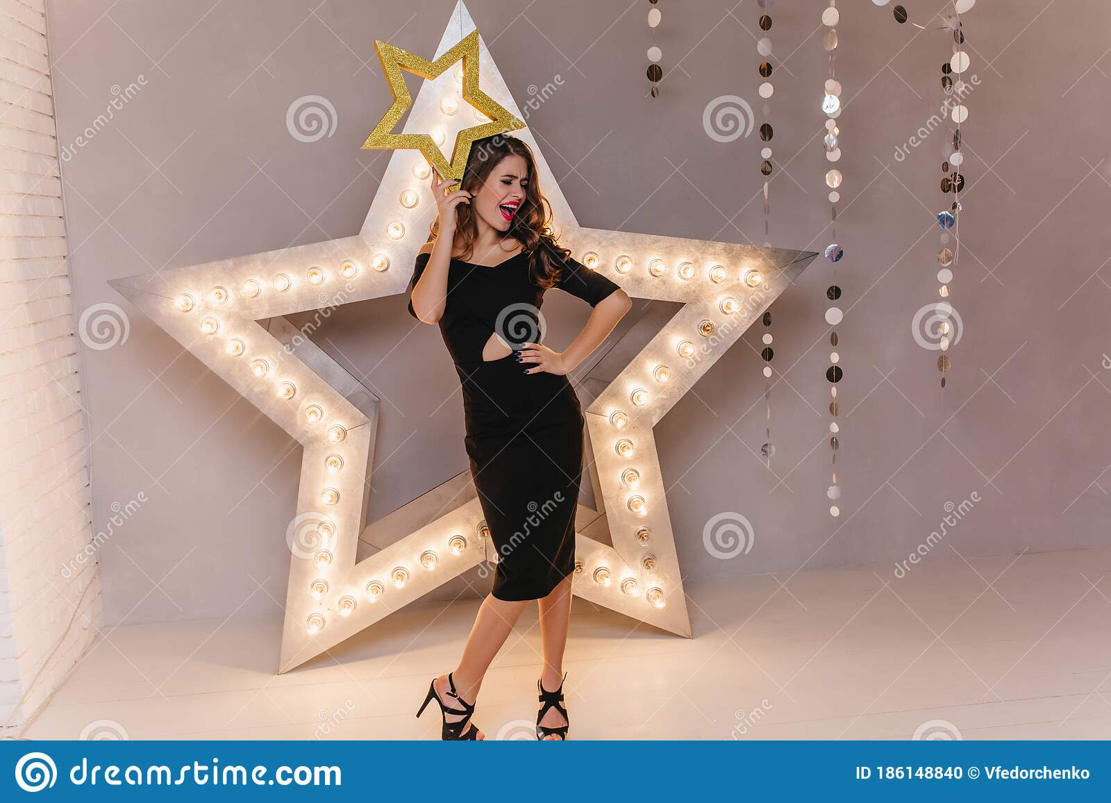 Mischievous Lady In Black Dress