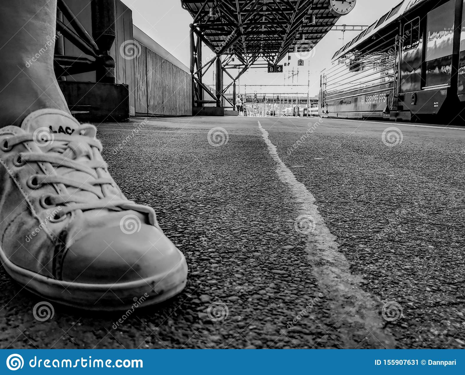 Sneakers on train station in black and white