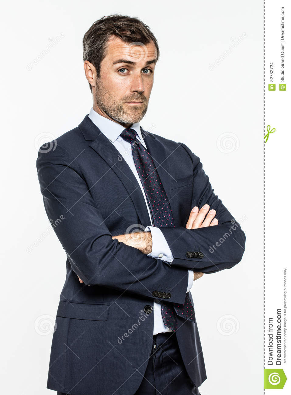 Snob Middle Aged Businessman With Arms Crossed Standing With