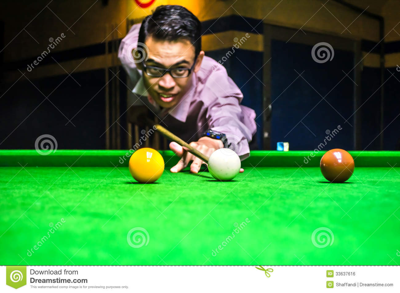 Snooker Player Placing The Cue Ball For A Shot Royalty