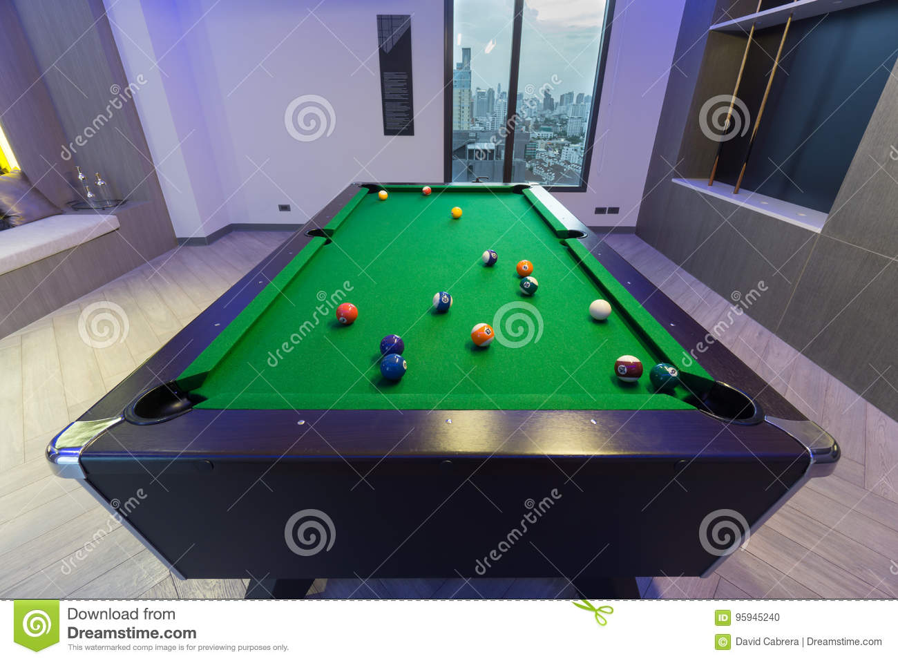 Snooker Pool Billiards green table with complete set of balls in a middle of a game in a modern games room