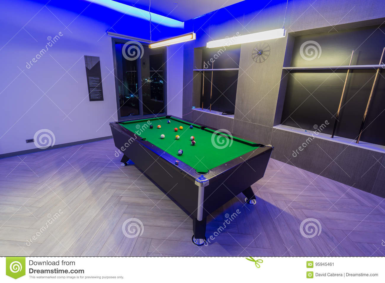Snooker Pool Billiards room, green table with complete set of balls in a modern room with neon lights