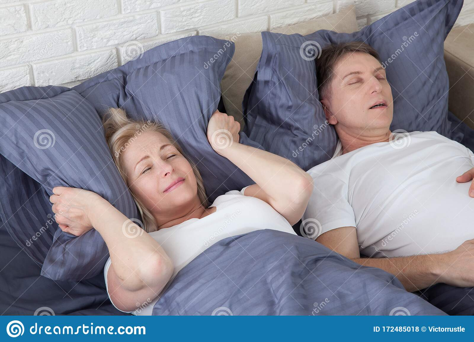 Snoring Man Couple In Bed Man Snoring And Woman Can Not Sleep Covering Ears With Pillow For Snore Noise Middle Age Stock Photo Image Of Annoying Caucasian 172485018