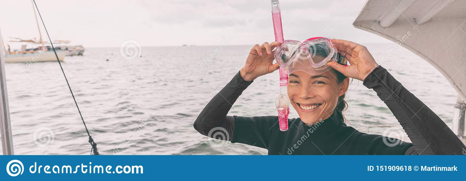 Snorkel mask Asian woman tourist getting ready for snorkeling activity tour from boat banner