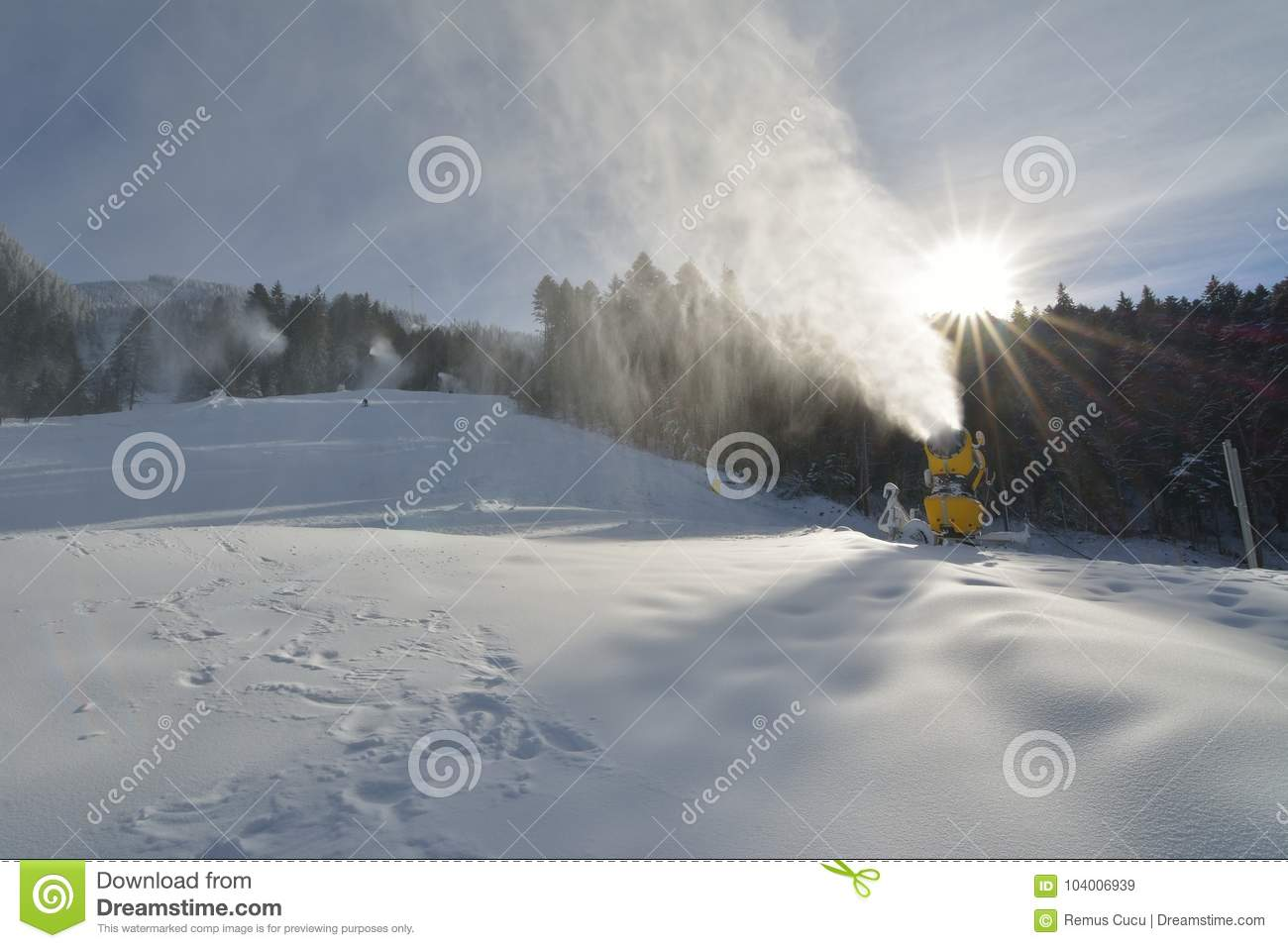 snow cannons making artificial snow on a ski slope in poiana brasov