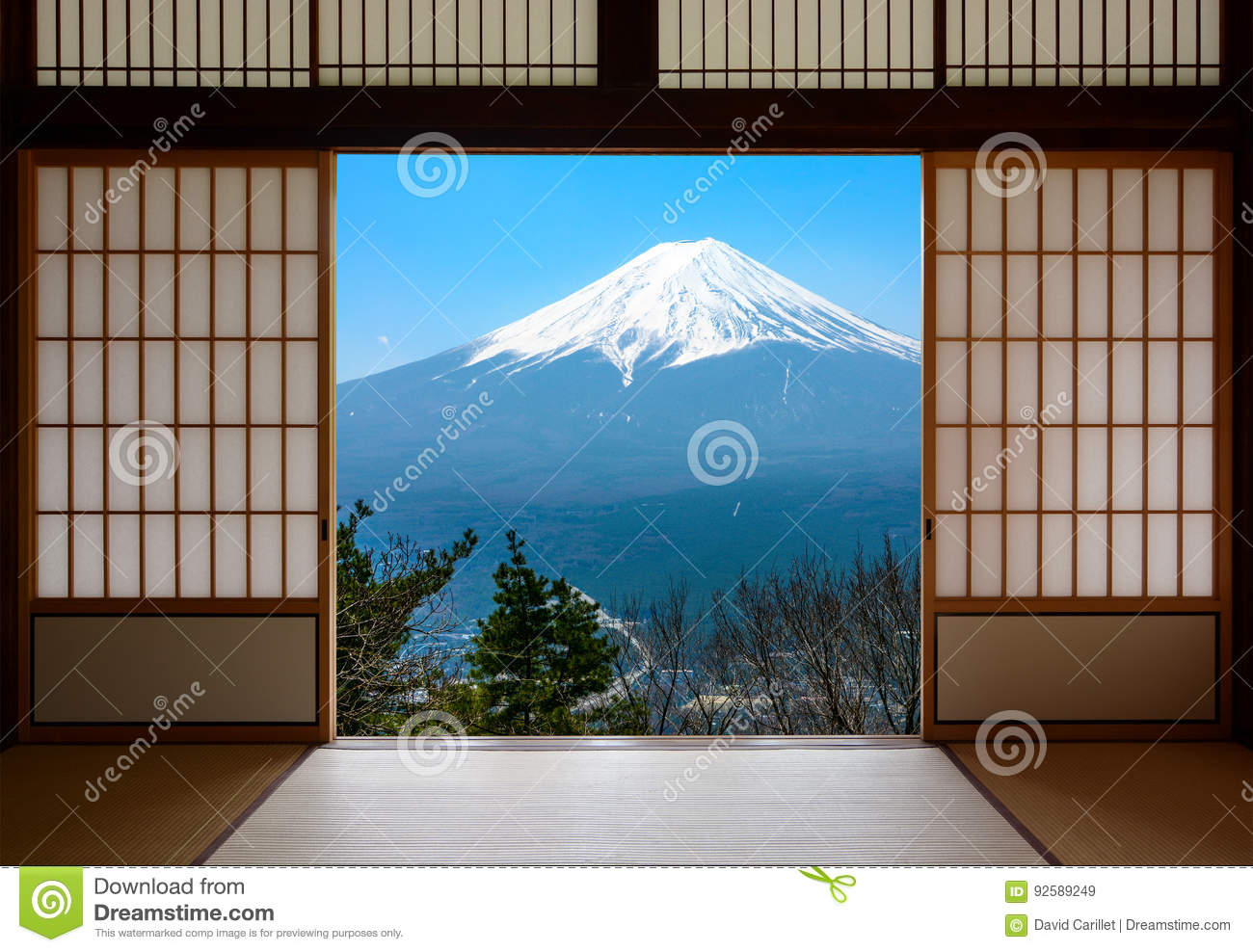 Snow capped Mount Fuji in Japan seen through traditional Japanese sliding paper doors