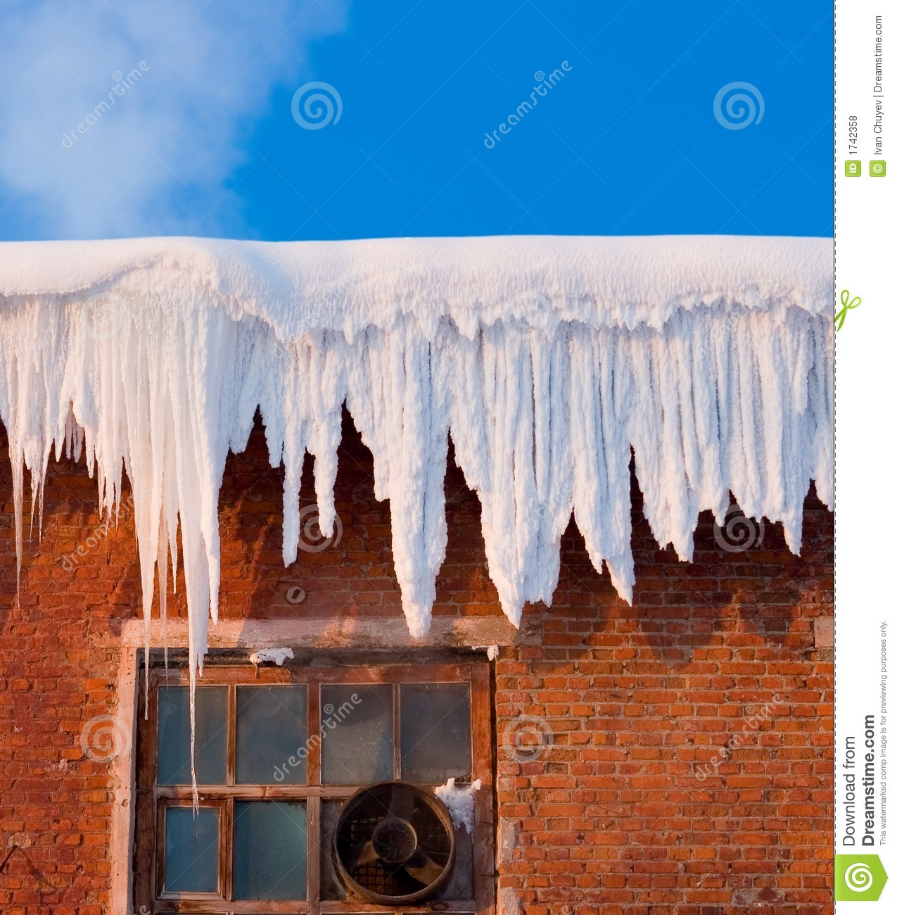 Snow Cover On Roof Of Old Textile Fabric With Icicles