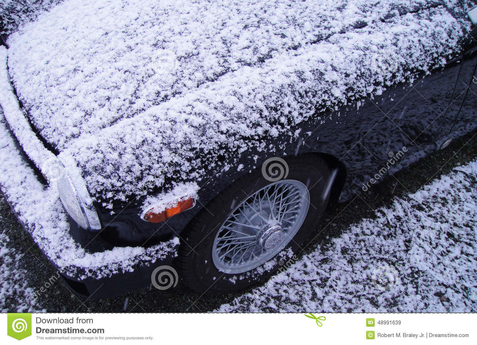 Snow Covered Black Vintage Car