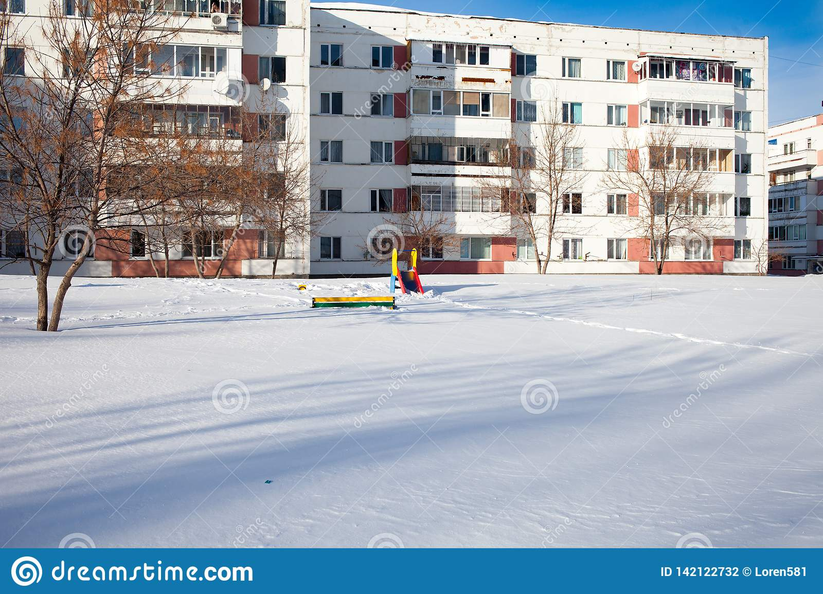 Snow-covered children`s and sports grounds in Russia. Poor cleaning of snow. Inaction of public services