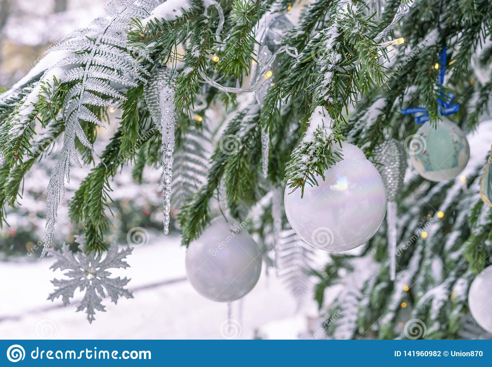 Icicles For Christmas Trees.The Snow Covered Christmas Tree Is Decorated With White