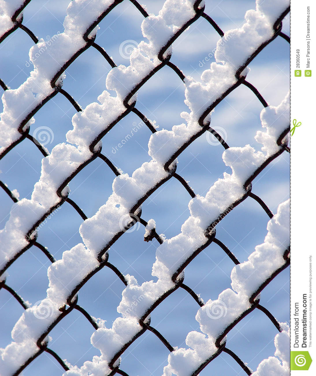 Chain link fencing covered by snow royalty free stock