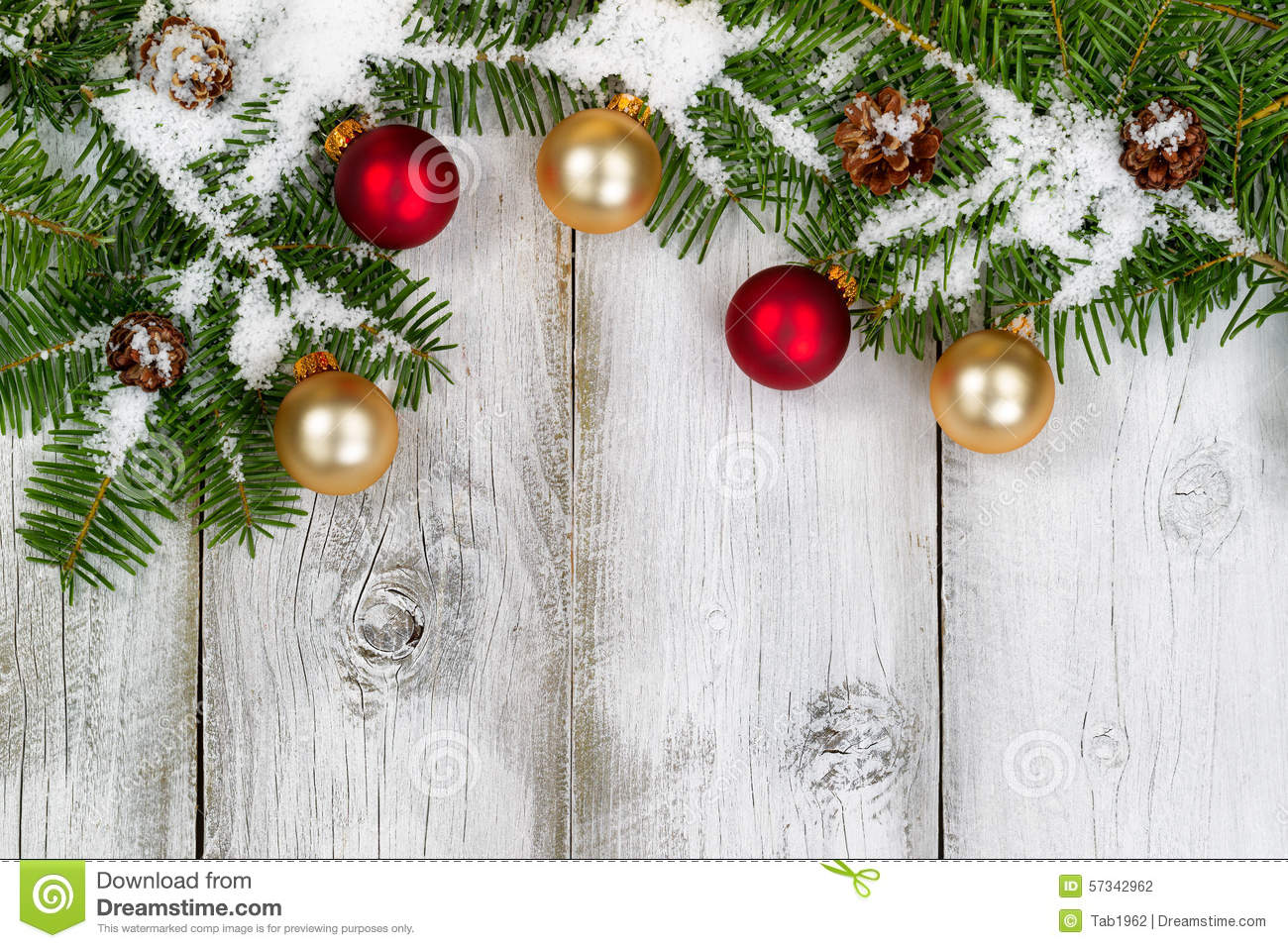 Snow Covered Fir Branches And Ornaments On