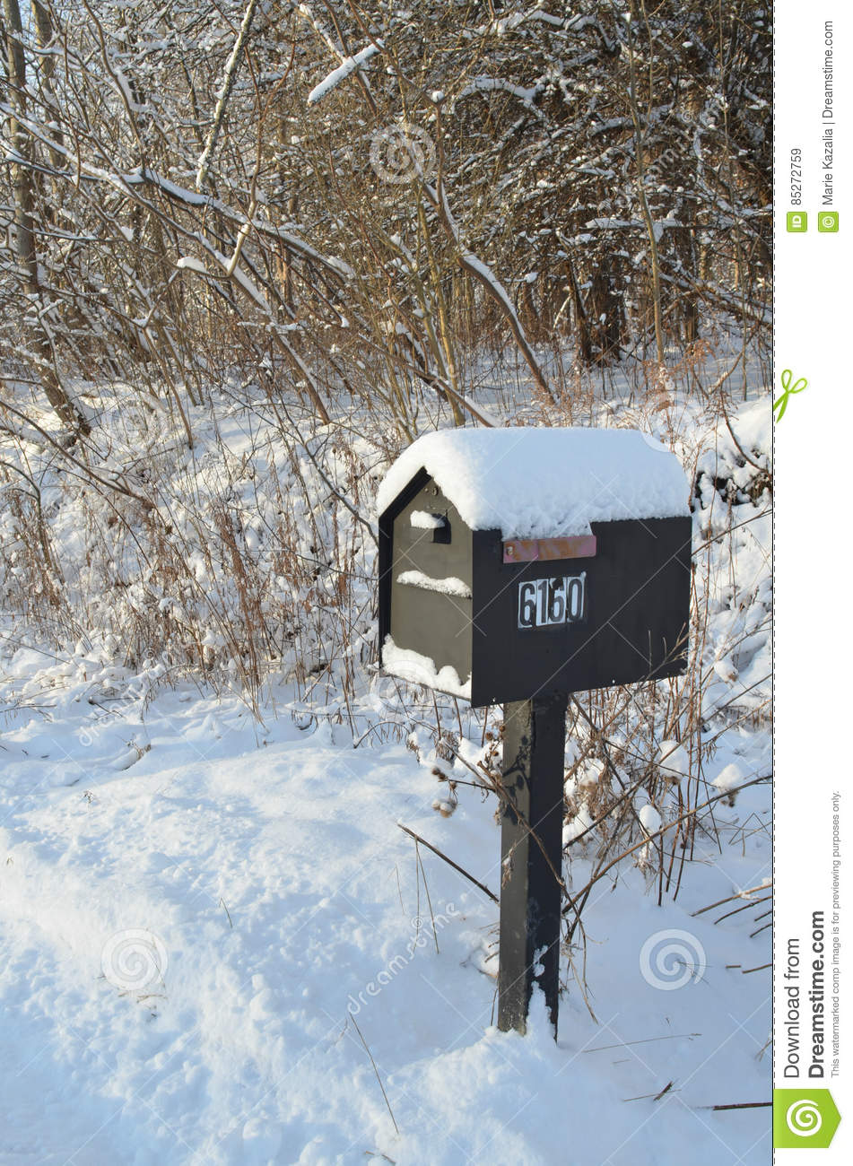 Snow Covered Mailbox On Rural Road On Winter Morning Stock