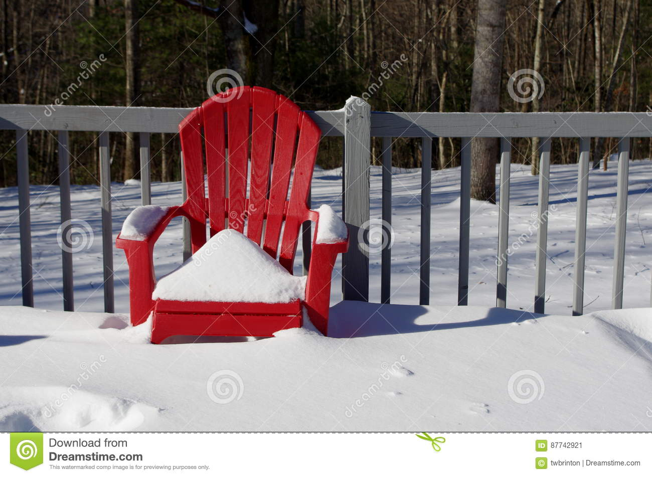 Download A Snow Covered Red Chair On A Wooden Deck Stock Image - Image of sitting, snow: 87742921