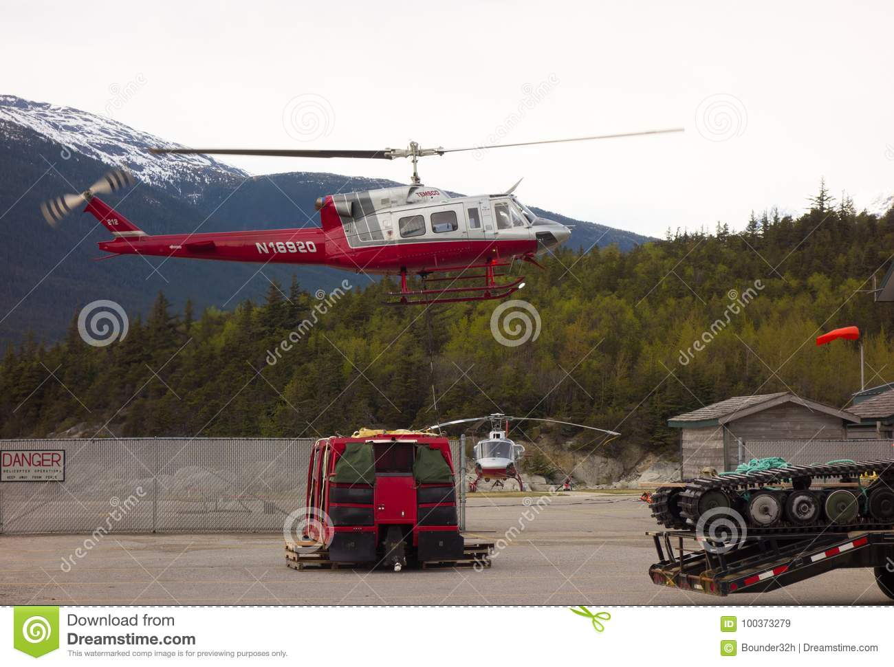 Heavy Equipment Being Transported By Helicopter In Alaska Editorial