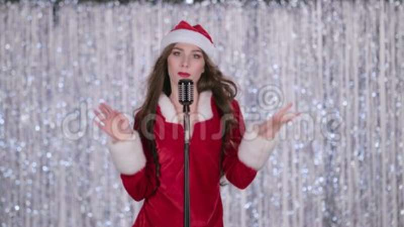Snow maiden sings in a retro microphone and dances with energetic music   Bokeh background