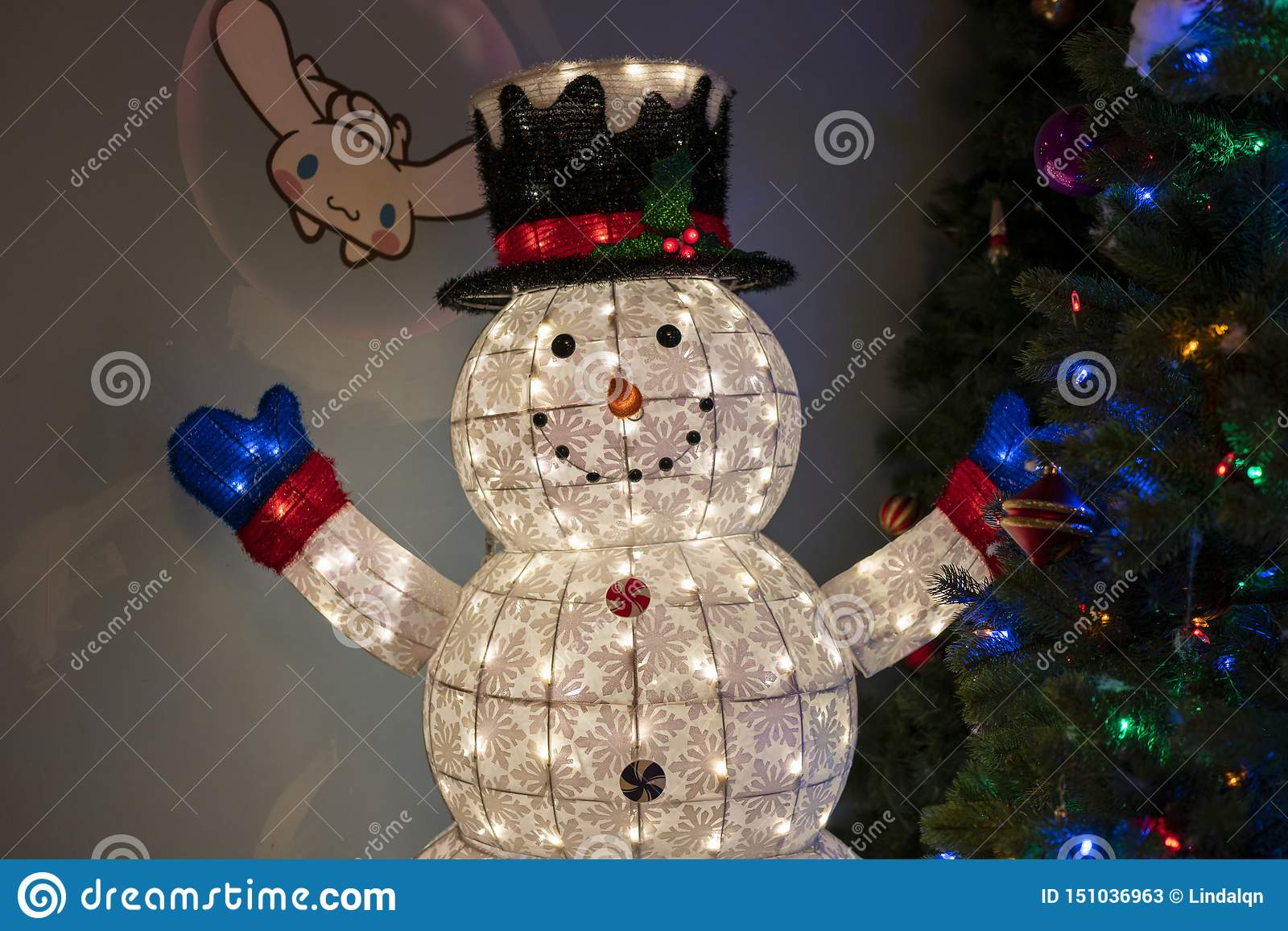 Snow Man And Christmas Tree In Hello Kitty Island Editorial