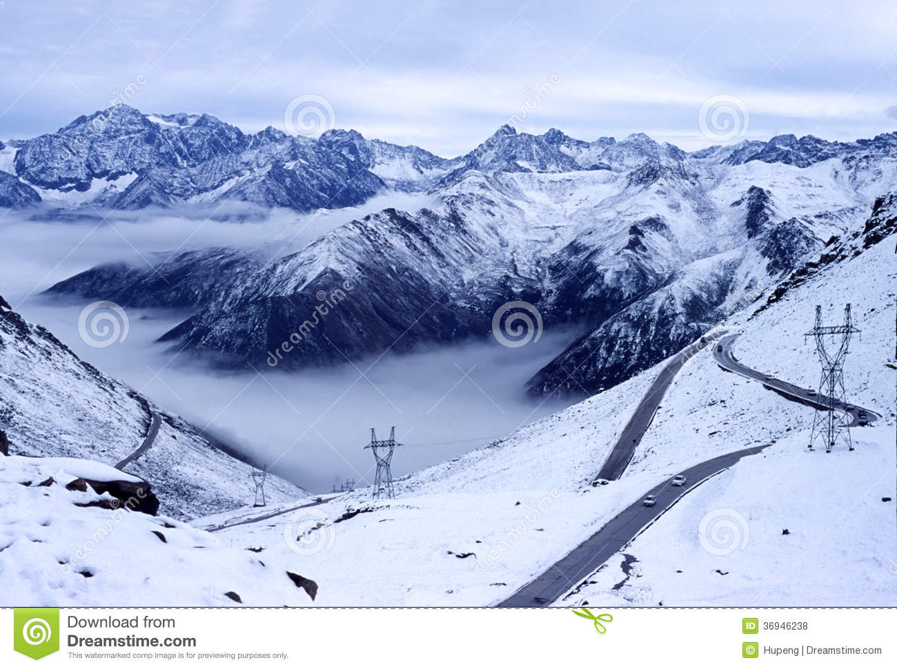 Snow mountains with road