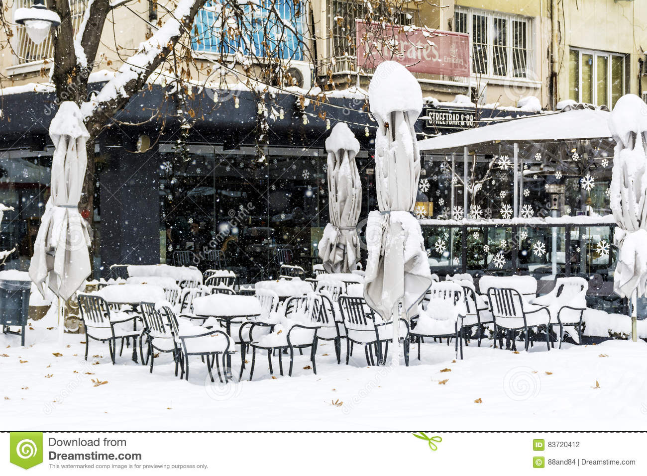 Snow Piles Up On A Tables And Chairs In A Coffee Bar Editorial Photography