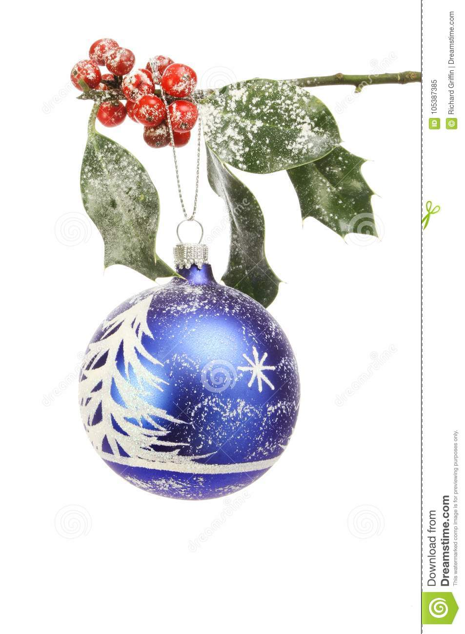 Snow scene bauble in holly