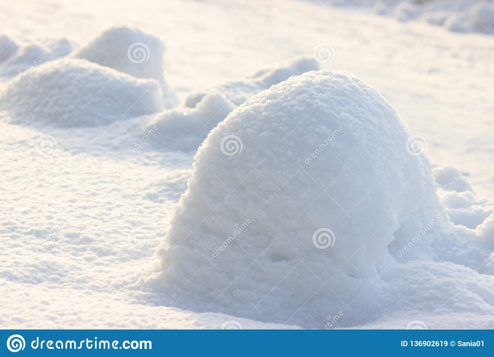 Snow snowbank on a Sunny day. Fluffy snow shimmers in the sun, abstract natural figures