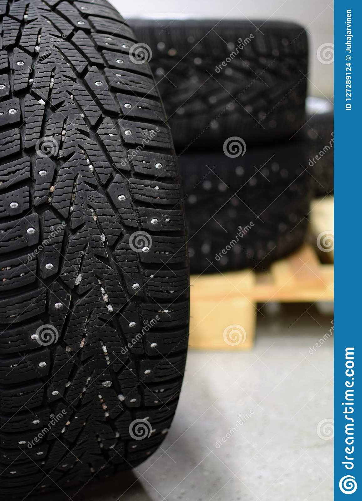 Snow tires with metal studs in garage