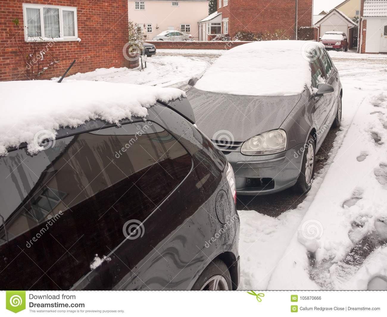 Snow On Top Of Parked Cars Outside Front Street Residential Area