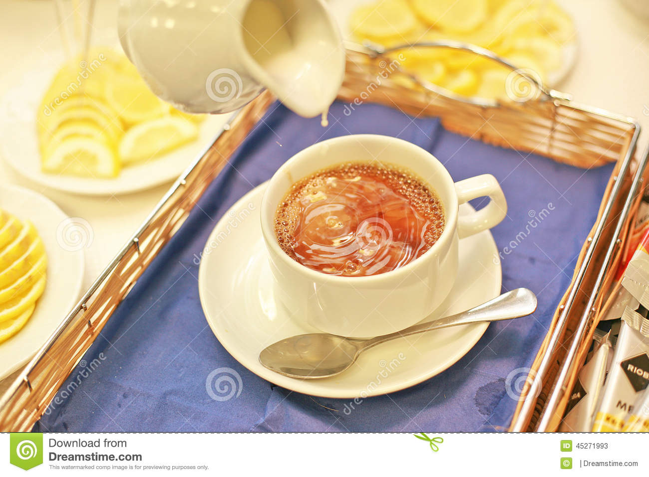 Download A Snow White Cup Of Tea With Milk Stock Image - Image of lemon, pours: 45271993