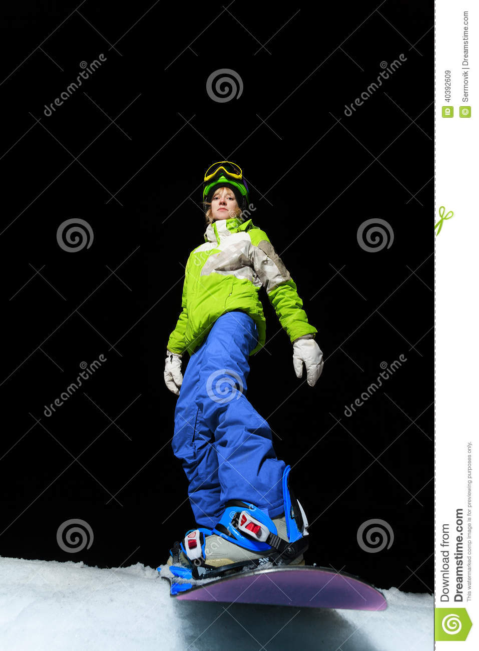 eb48a74e8562 Portrait of cool snowboard girl ready to slide down the mountain at night