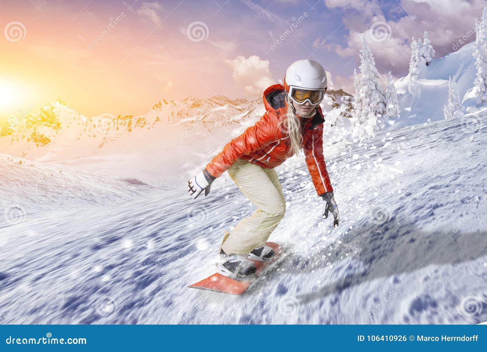 Snowboarder Glides With High Speed Downhill Through The Powder Snow ...