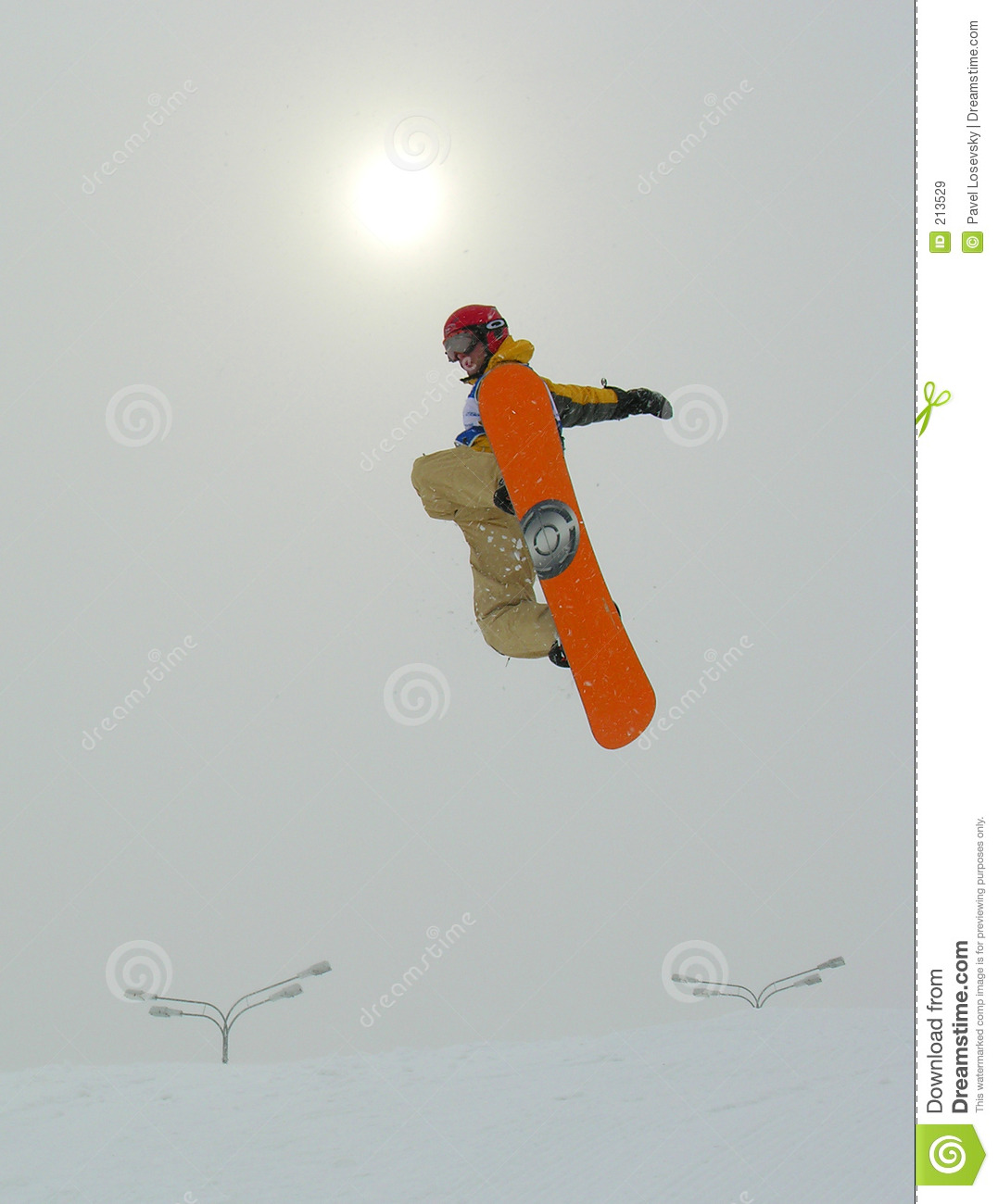 Snowboarder Jumping and sun