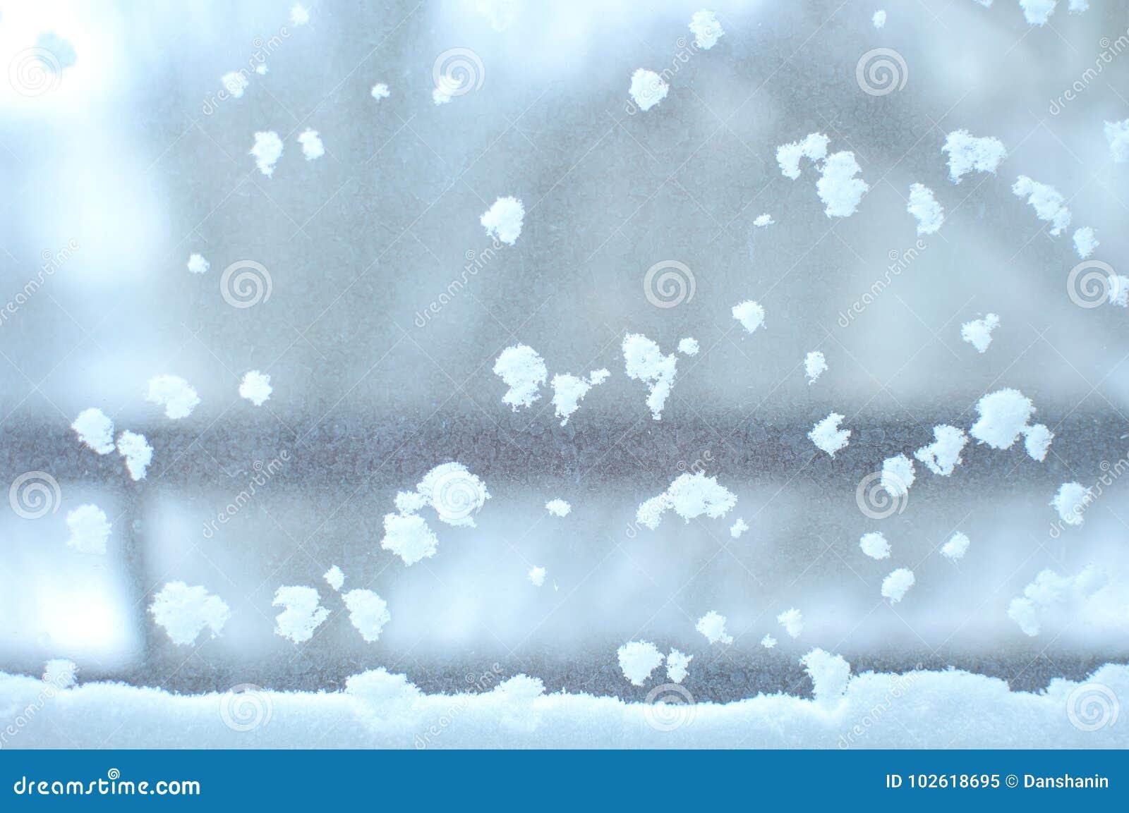 Snowbound window close-up, indoor. Seasonal winter weather conditions. Snowy winter background