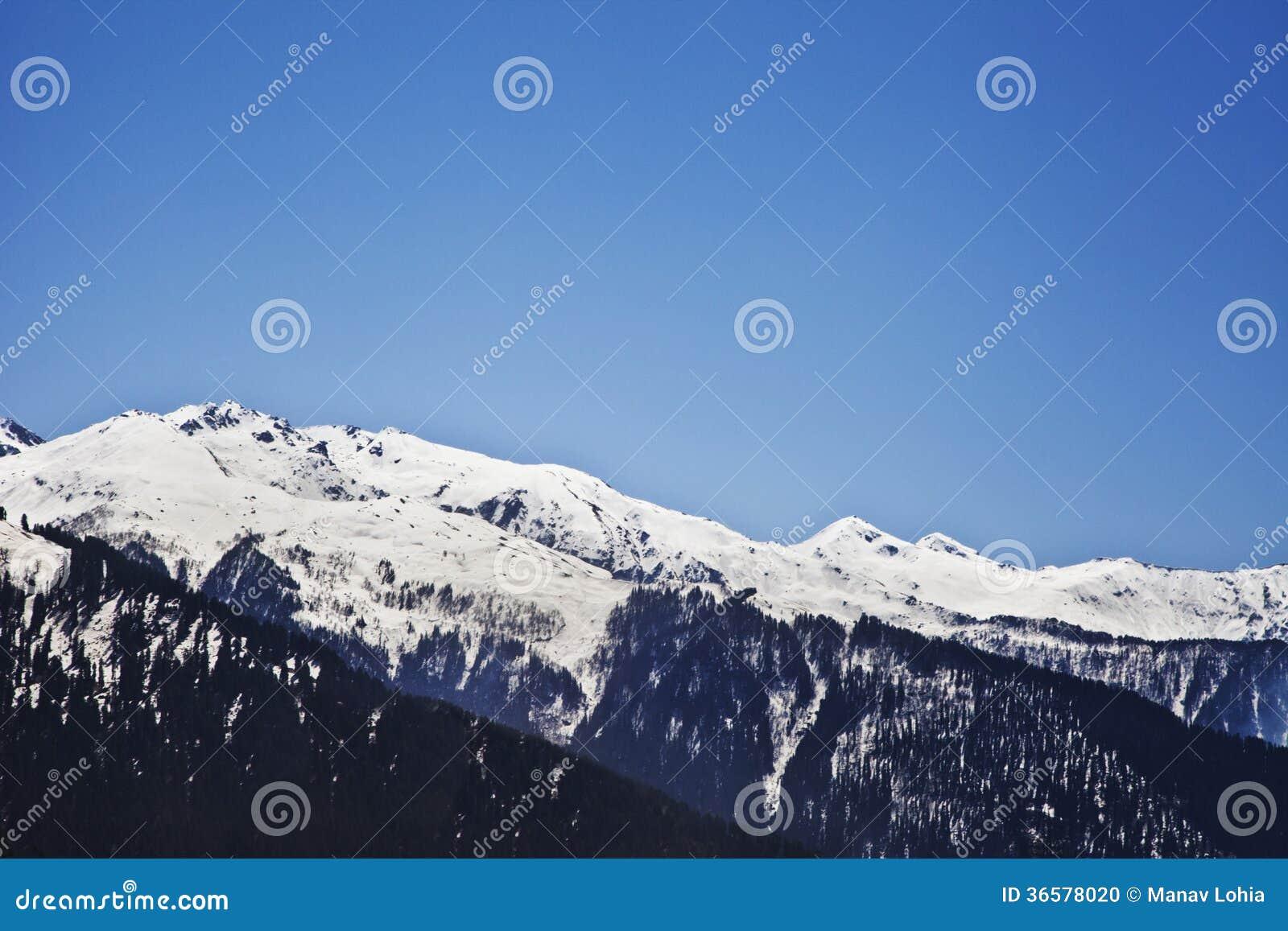 Snowcapped mountain range manali himachal pradesh india stock photo