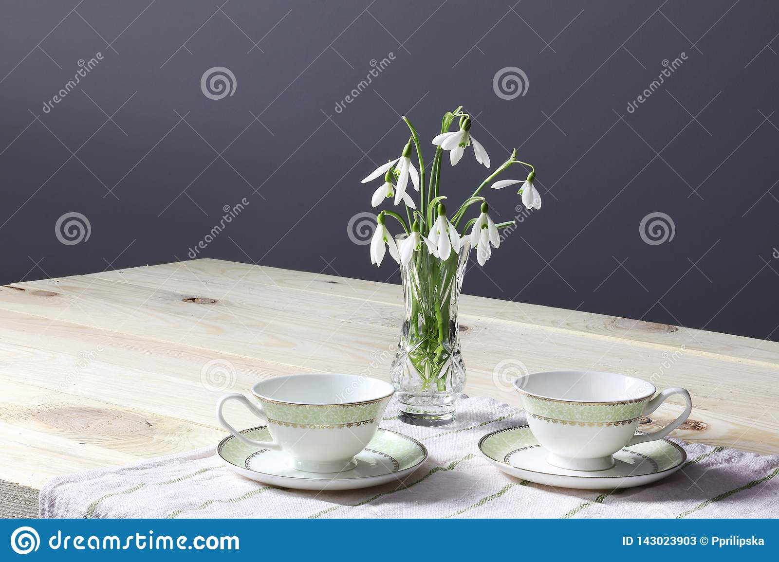 Snowdrops on the table. Spring flowers bouquet. Snowdrops background. Spring flowers on the wooden table. Holiday desk. Holiday fl
