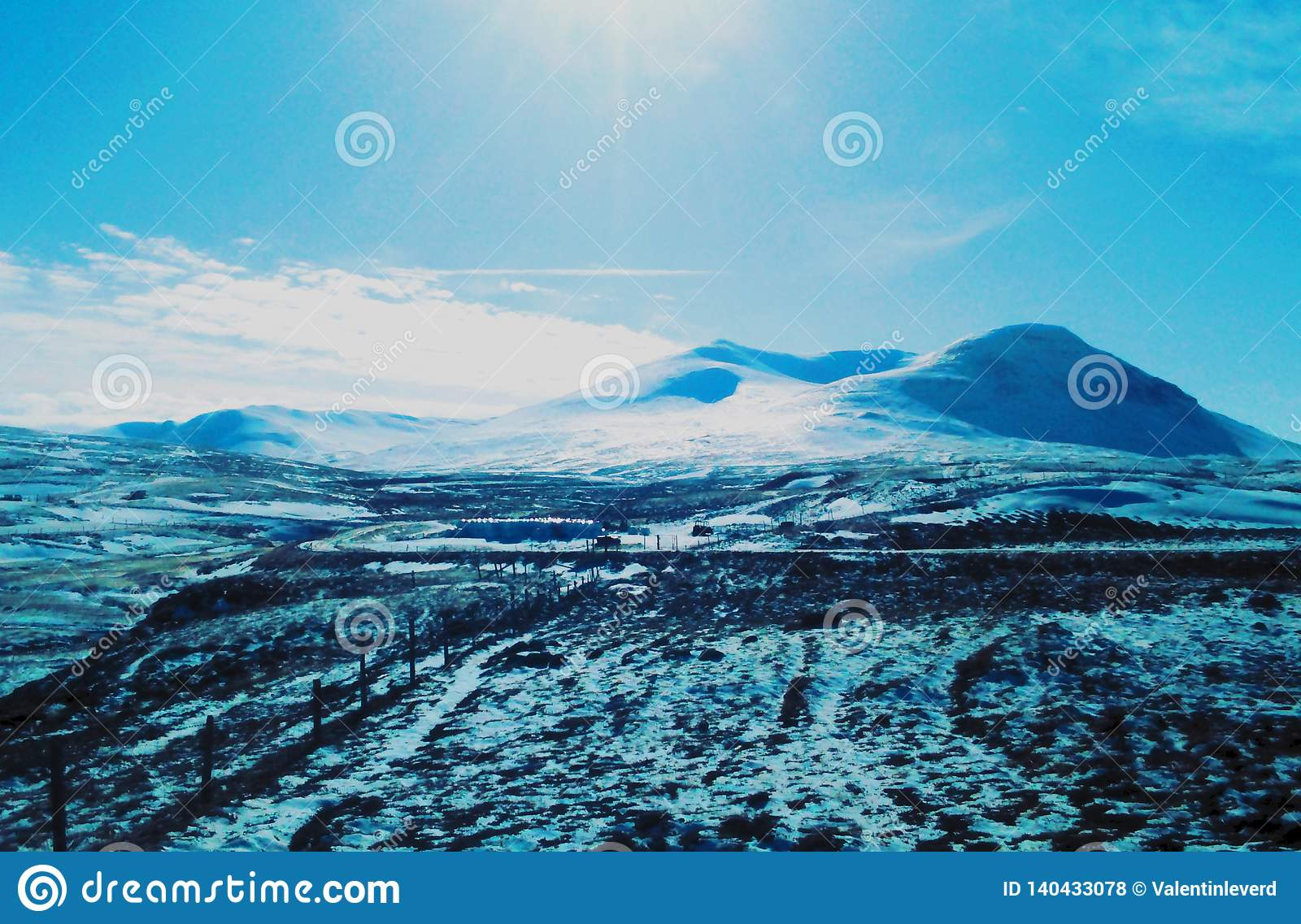 Snowing field with blue sky