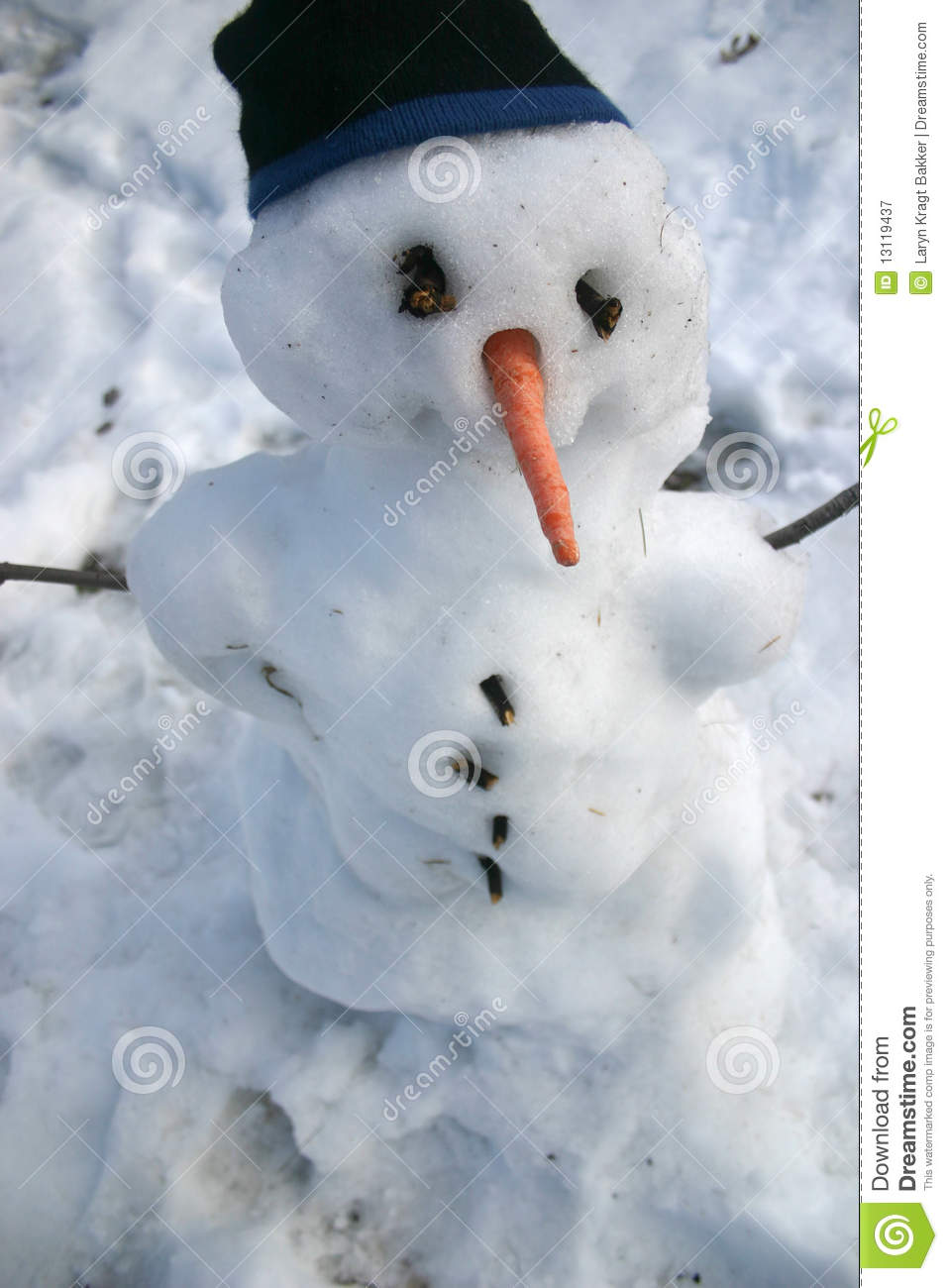 snowman with carrot nose and toque royalty free stock