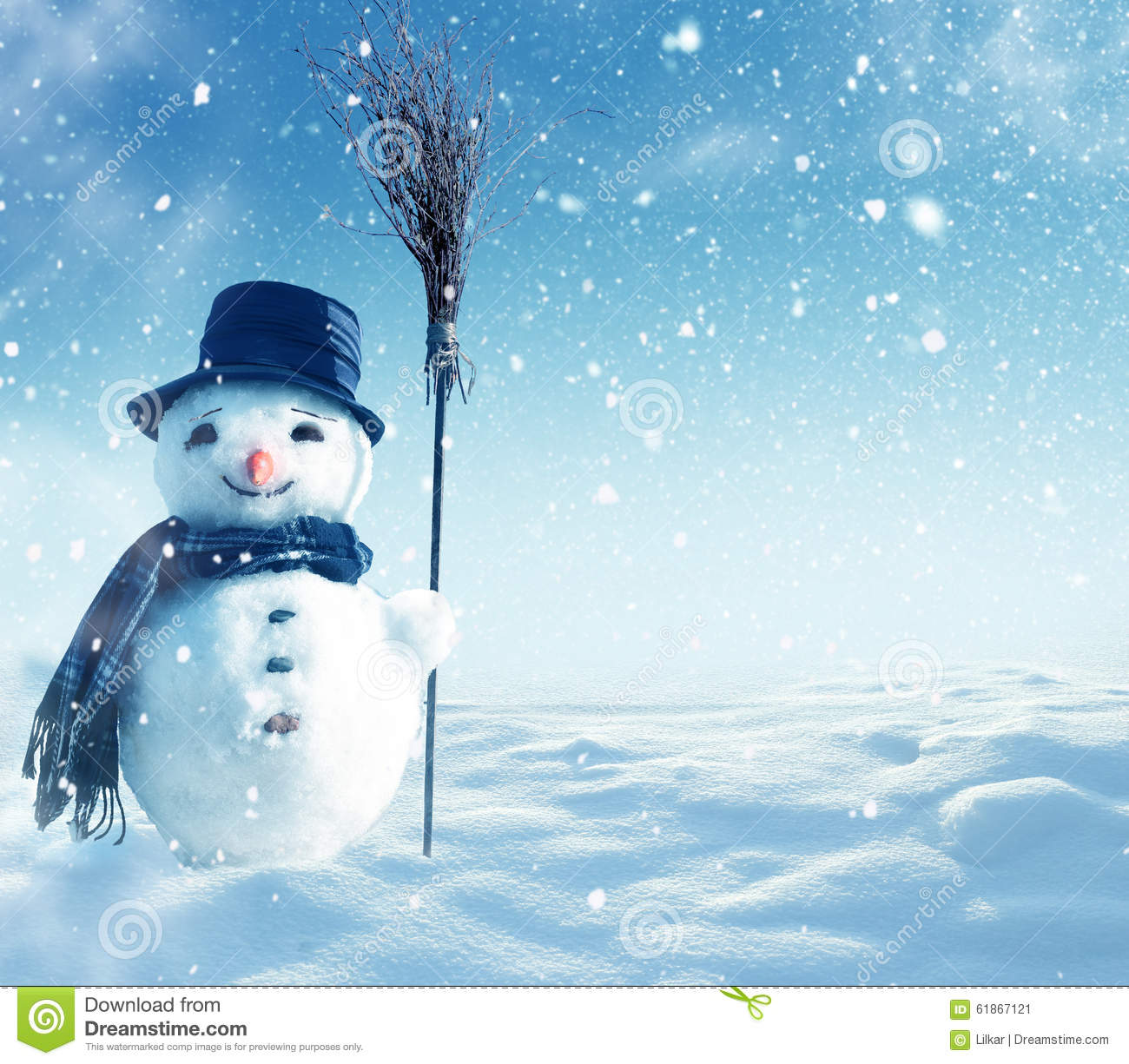 Snowman standing in winter christmas landscape