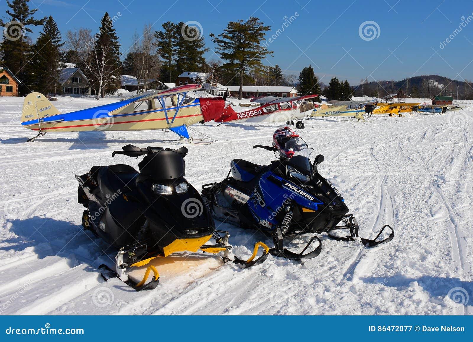 Snowmobiles and ski planes