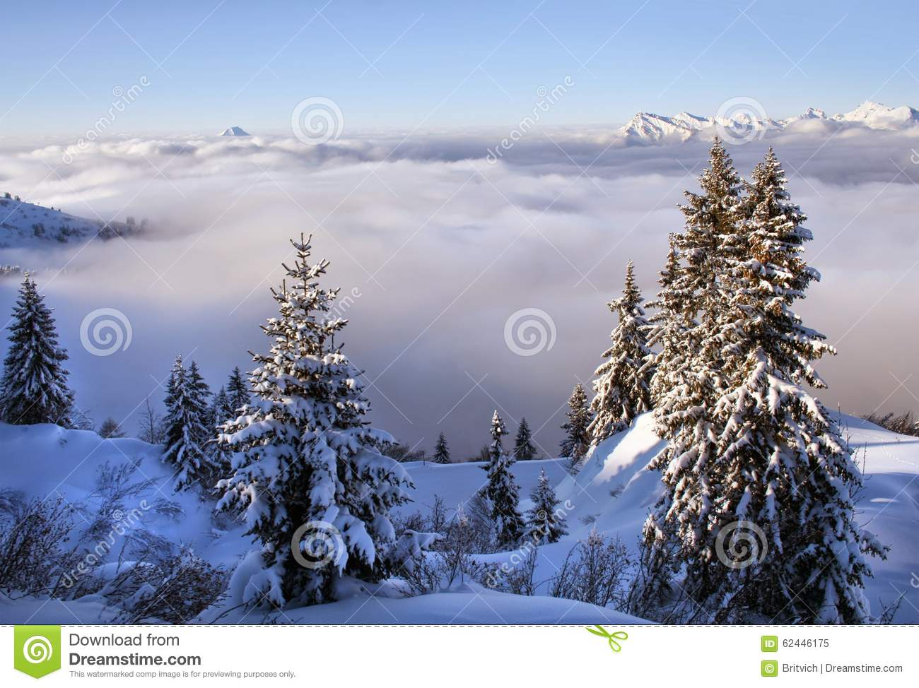 Snowy Alps with clouds