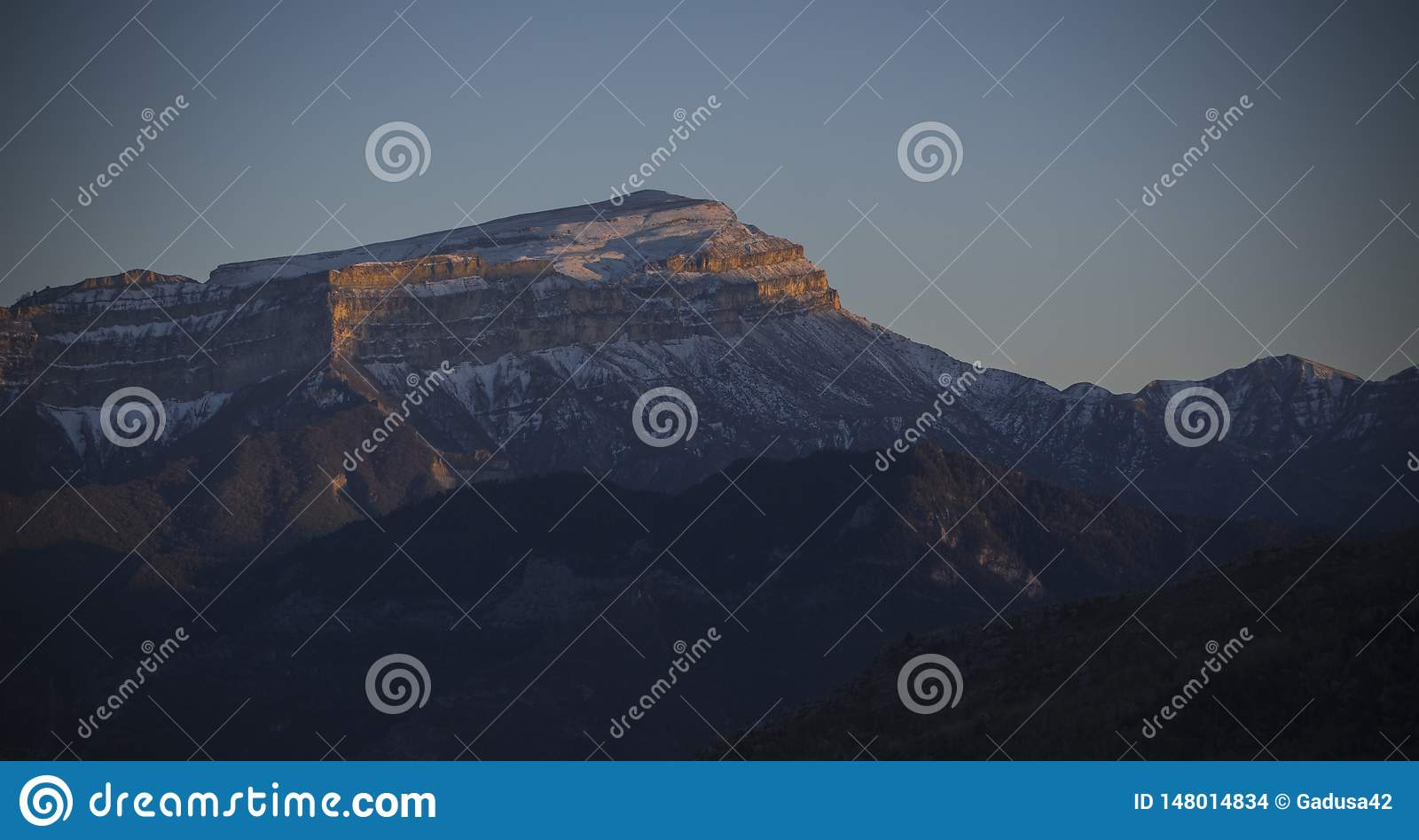 Snowy caucasus mountain at sunset