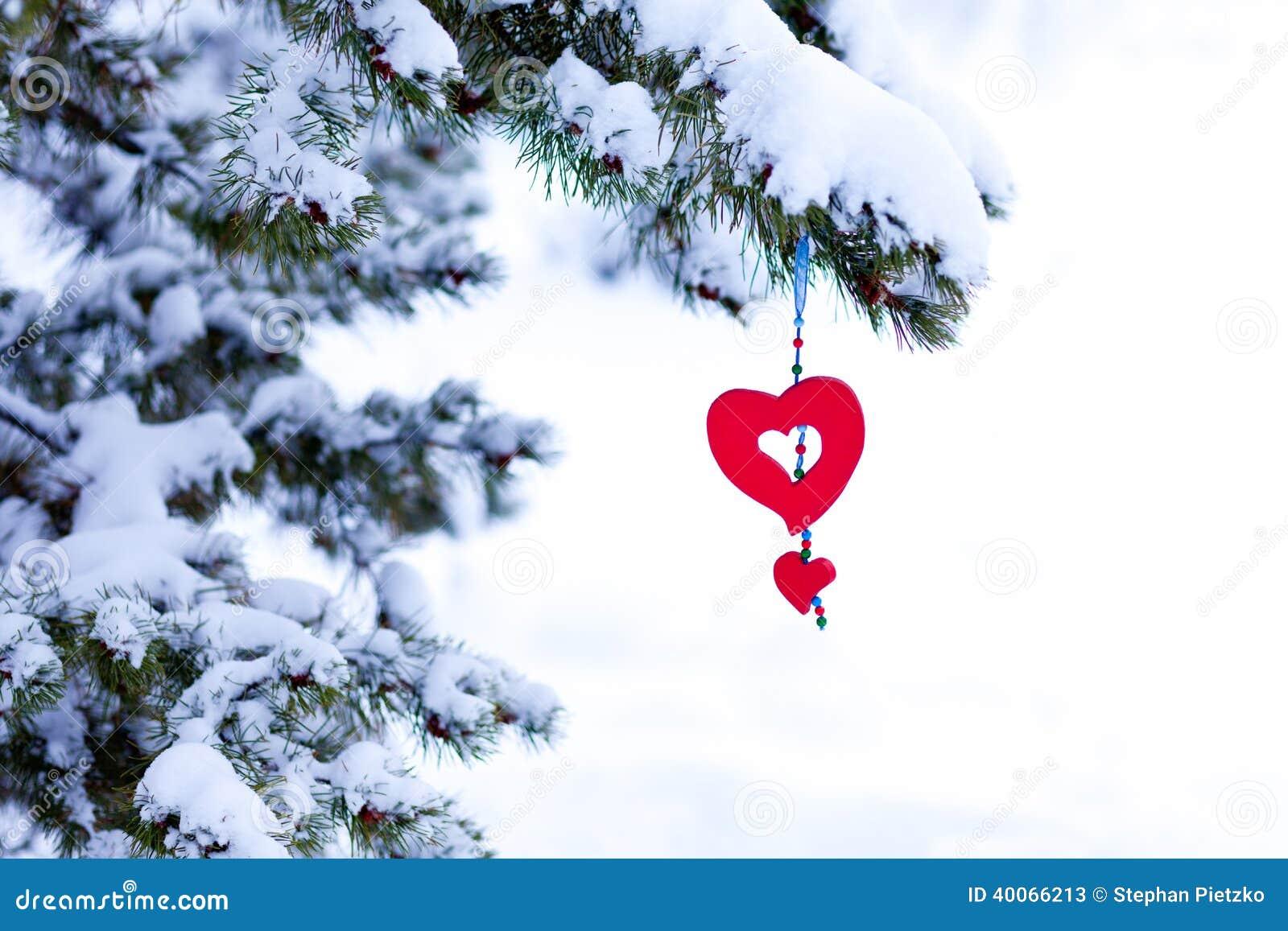 Snowy Christmas Tree Red Heart Ornament Stock Photo