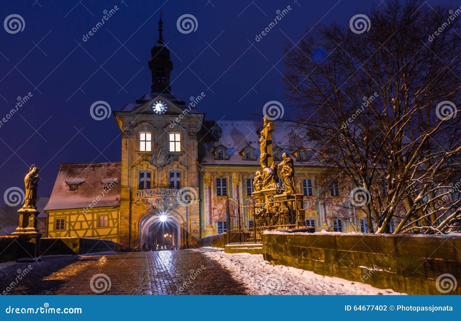 snowy cityscape at dusktown hall bamberggermany stock