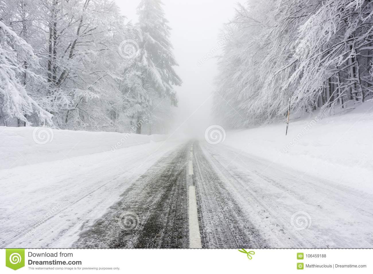 Snowy and icy road in foggy weather