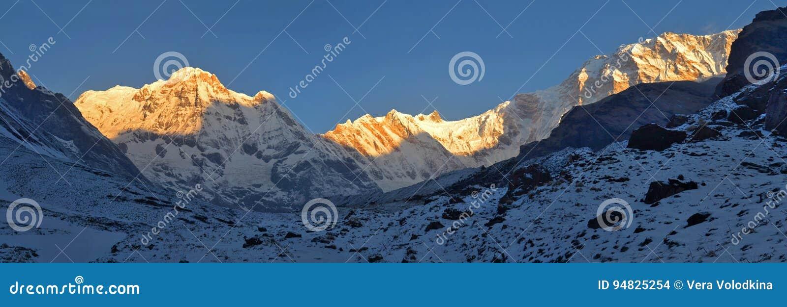 Snowy Landscape Panorama in Himalaya Mountains. Sunrise Annapurna South peak, Annapurna Base Camp .