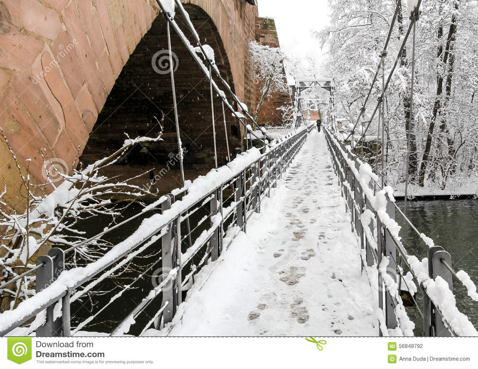 Snowy Nuremberg, Germany- iron bridge ( Kettensteg), old town city walls